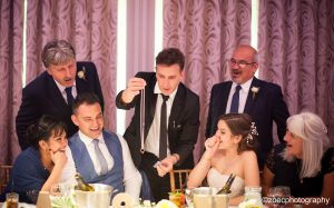 Wedding magician with the bride and groom